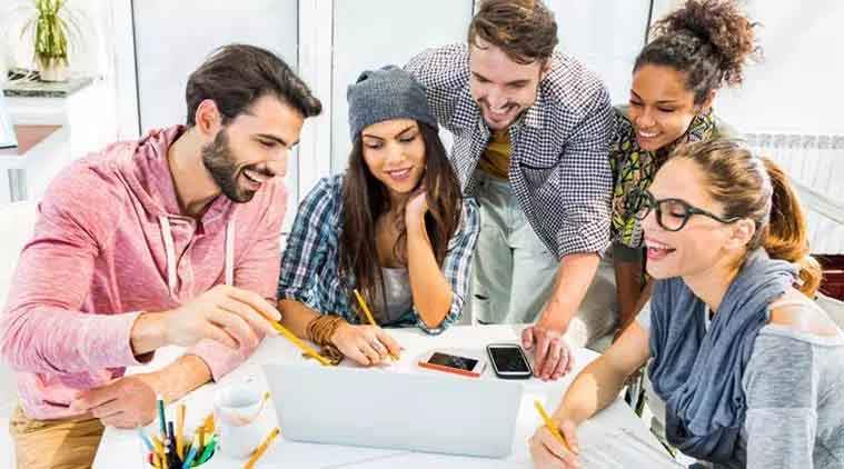 Group of people enjoying their work in a startup